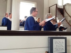 Choir in robes with hymnal